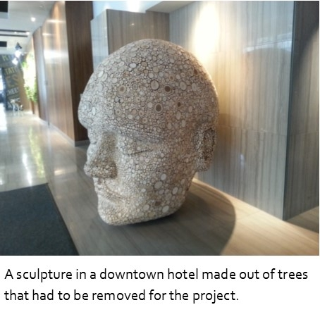 A sculpture shaped like a large head in a lobby of a hotel
